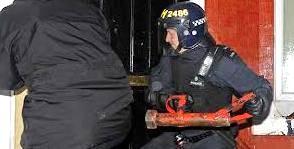 police battering door