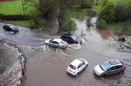 flood aqueduct road cars mill around